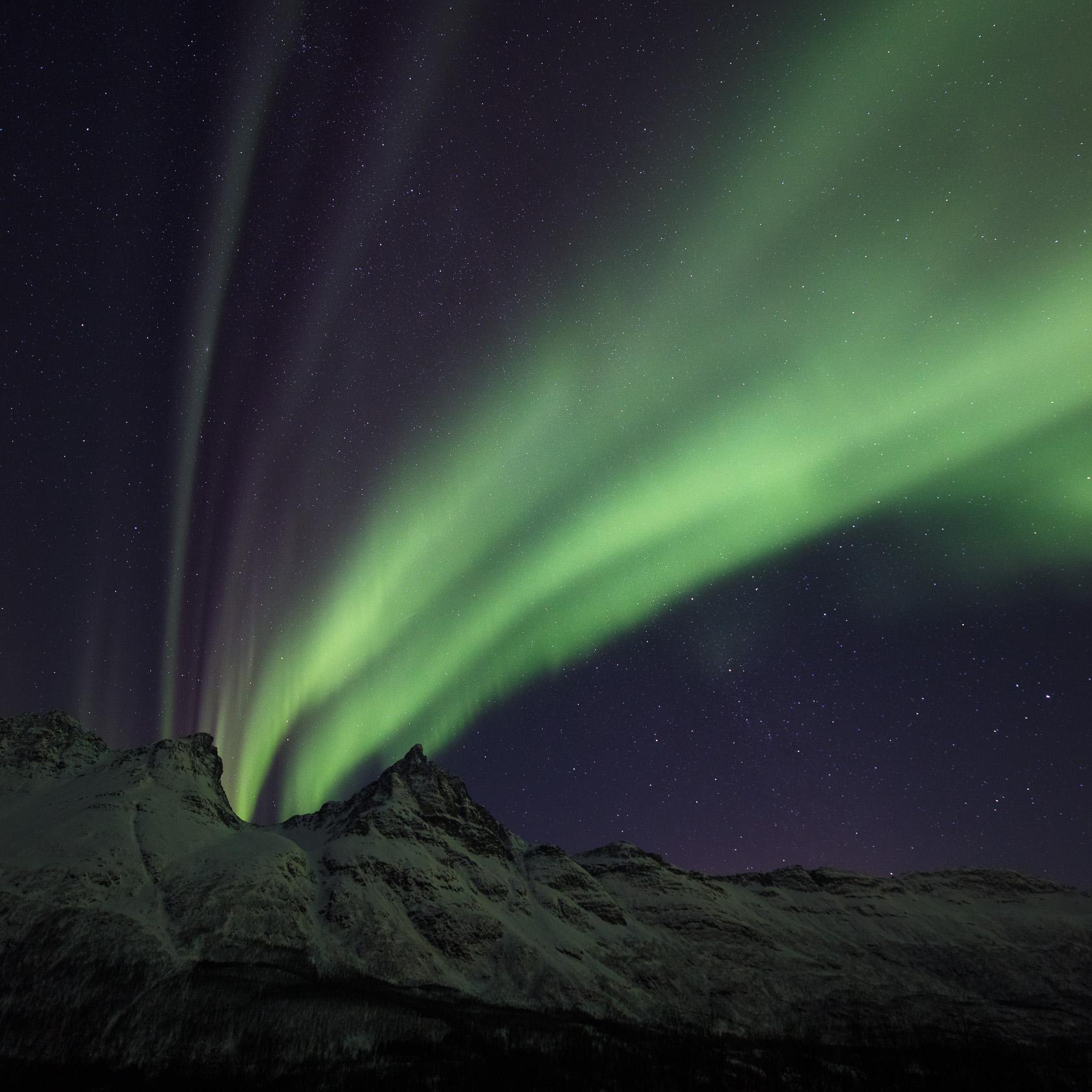 aurore boréale photographiée lors d'un voyage photo dans les Alpes de Lyngen, en Norvège